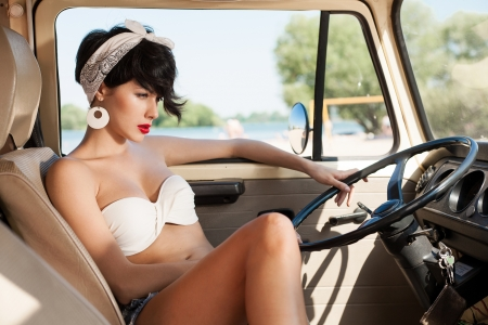 white women: Sensual young woman relaxing in car near the beach - outdoors