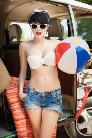 Young woman with beach ball photo