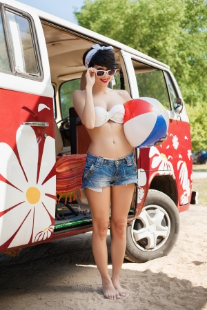 Young caucasian woman with beach ball photo