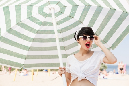 glamorous girl in retro style by color umbrella - outdoors photo