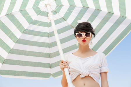 young woman in retro style by color umbrella - outdoors photo