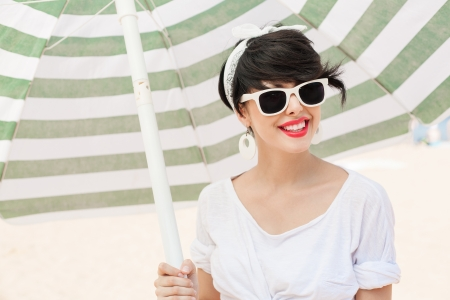 young woman in retro style by color parasol - outdoors