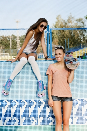 Two young pretty women in park, outdoors Stock Photo - 15646555