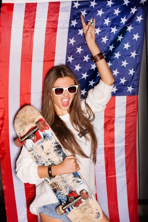 state of mood: beautiful young pretty woman in sunglasses with national usa flag in background Stock Photo