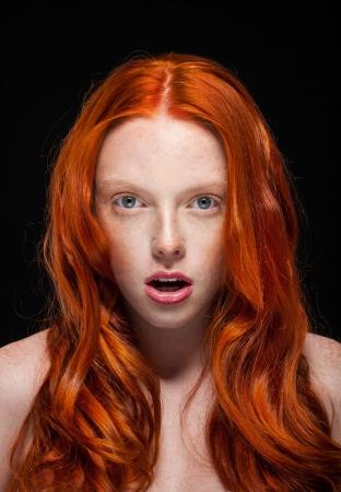 Golden Fashion Girl Portrait.Wavy Red Hair. Wonder photo