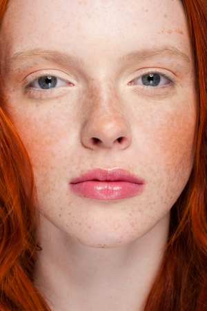 young beautiful girl with wavy red hair photo