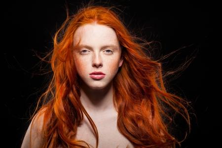 Golden Fashion Young Girl Portrait.Wavy Red Hair. Wonder photo