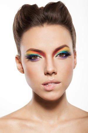 beautiful female face with rainbow makeup. intriguing girl biting her lip Stock Photo - 16826326