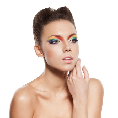 beautiful female face with rainbow makeup. girl touch her face by hand Stock Photo - 16826323