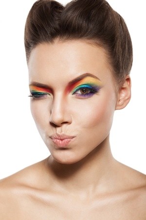 beautiful female face with rainbow makeup. girl is winking pursed lips Stock Photo - 16826331