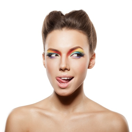 beautiful female face with rainbow makeup. girl winking and showing tongue photo