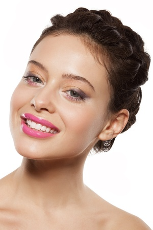 beautiful female face with makeup. girl is smiling photo
