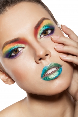 beautiful female face with rainbow makeup. girl touch her face by hand Stock Photo - 17009296