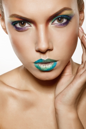 beautiful female face with rainbow makeup. girl touch her face by hand Stock Photo - 17009300