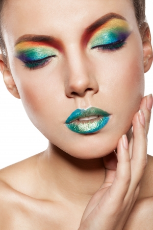 beautiful female face with rainbow makeup. girl witn closed eyes touch her face by hand Stock Photo - 17009302