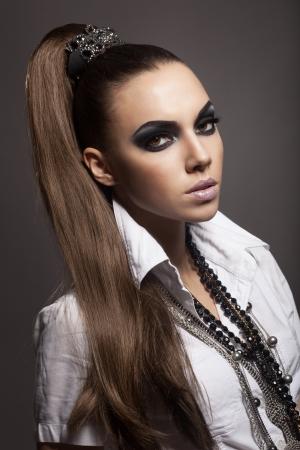 smokey: Sexy woman with long hair, make-up and smokey eyes