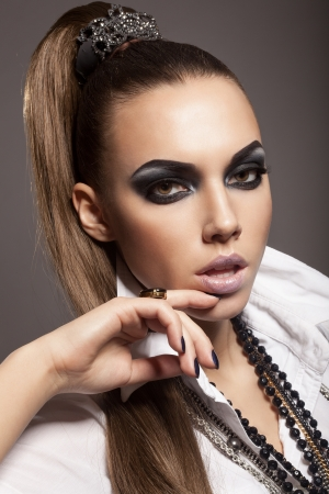 Sexy woman with long hair, make-up and smokey eyes Stock Photo - 17241017
