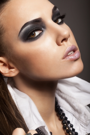Sexy woman with long hair, make-up and smokey eyes Stock Photo - 17241067