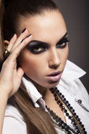 Sexy woman with long hair, make-up and smokey eyes Stock Photo - 17241015