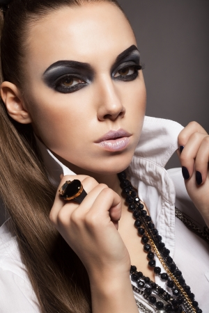 Sexy woman with long hair, make-up and smokey eyes Stock Photo - 17241016