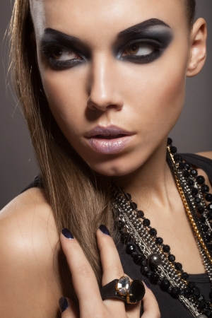 Sexy woman with long hair, make-up and smokey eyes Stock Photo - 17241013