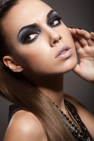 Sexy woman with long hair, make-up and smokey eyes Stock Photo - 17241064