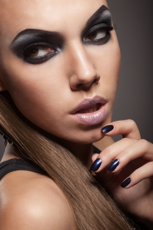 Sexy woman with long hair, make-up and smokey eyes Stock Photo - 17241012
