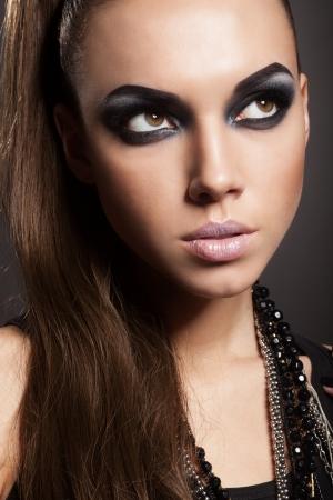 Sexy woman with long hair, make-up and smokey eyes Stock Photo - 17241055