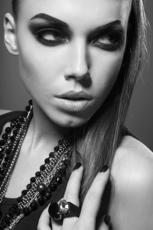 smokey: sexy woman with long hair, make-up and smokey eyes in black and white