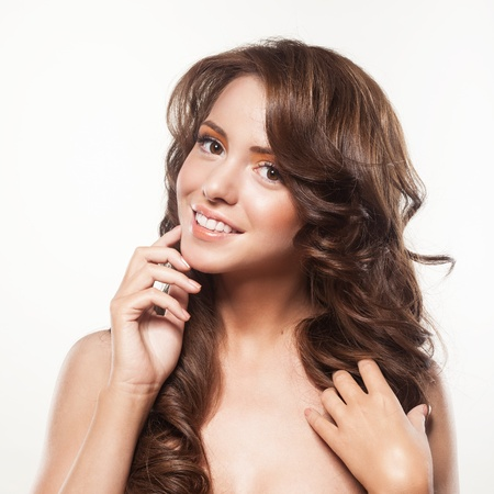 beautiful female face with make-up and shiny curly hair. Elegant hairstyle for long hair Stock Photo - 17383313