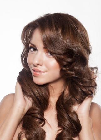 beautiful female face with make-up and shiny curly hair. Elegant hairstyle for long hair Stock Photo - 17383324