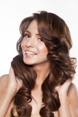 beautiful female face with make-up and shiny curly hair. Elegant hairstyle for long hair Stock Photo - 17383318