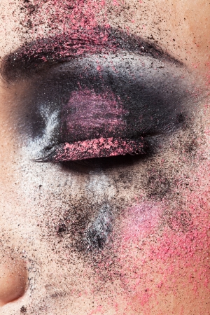 coloring lips: closeup beautiful female face with art makeup