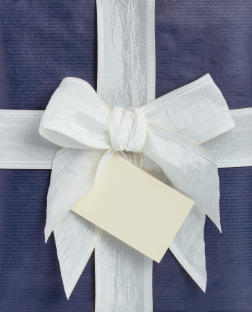 blue gift box: Blue gift box with white ribbon and beige note