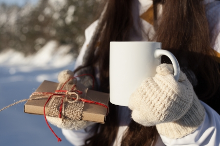 girl attractive drinking tea over winter nature background outdoor photo