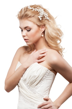 bride in white dress with beauty wedding coiffure photo