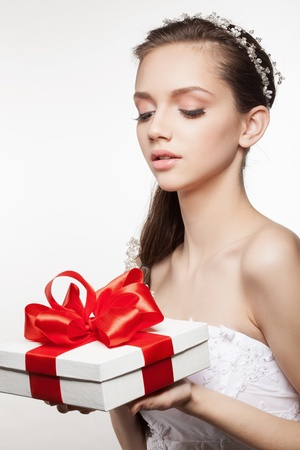 Beautiful elegance bride with small gift box photo