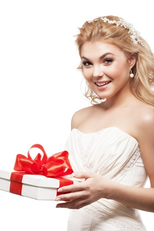 Beautiful blonde bride with white gift box photo