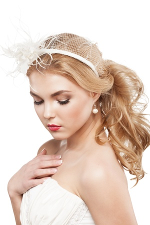 Beautiful blonde bride with beauty wedding coiffure photo