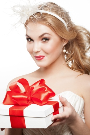 Beautiful blonde bride with white gift box Stock Photo - 17887452