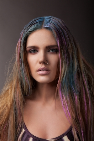young sexy woman with multicoloured hair, indoor photo