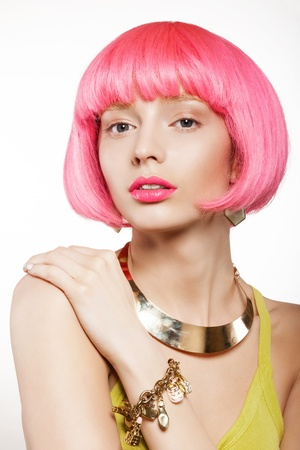 young woman in a bright pink wig, indoor