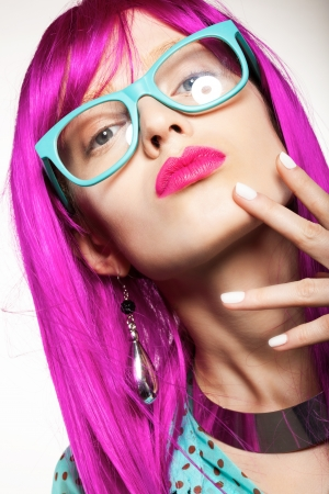 wig: young woman in a bright purple wig, indoor