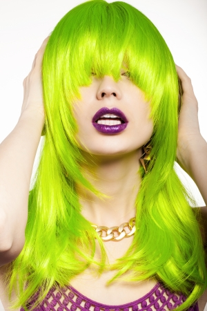 wig: young woman in a bright green wig, indoor Stock Photo