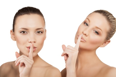 noiseless: two women making a hush gesture, isolated Stock Photo