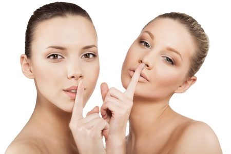 noiseless: closeup of young women making a hush gesture, isolated