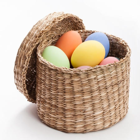 color eggs in wicker basket for holiday easter on white background Stock Photo - 18712028