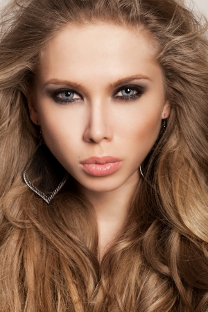 long brown hair: Beauty face of a beautiful girl with healthy long hair and fresh makeup with smoky eyes  Wavy Hair  Hairstyle  Not isolated on background
