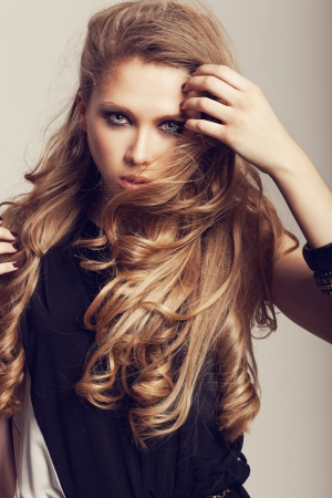 blond brown: beautiful girl with healthy long hair and fresh makeup  Wavy Hair  Hairstyle  Not isolated on background