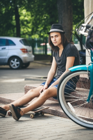 boy skater: Man with skateboard sitting on stairs
